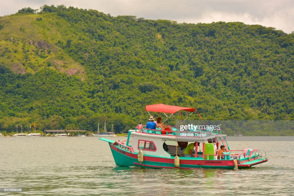 Day-trip tourist boat in the bay of Paraty, Rio de Janeiro : Stock Photo