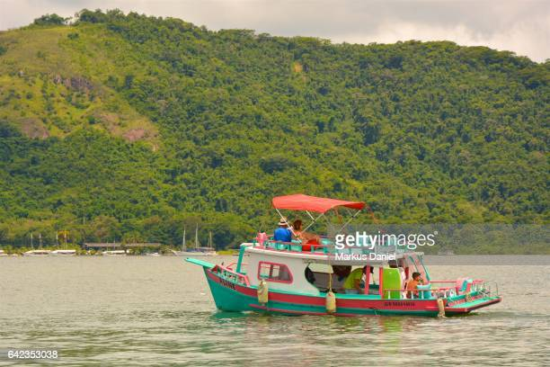 "day-trip tourist boat in the bay of paraty, rio de janeiro - ""markus daniel"" stock pictures, royalty-free photos & images"