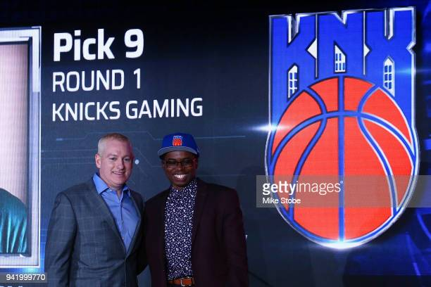 Dayvon Curry poses for a photo with NBA 2K League Managing Director Brendan Donohue after being drafted in the first round by Knicks Gaming during...