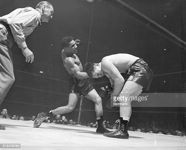 Dazed Morris Reif bends over after Jack Beau connects with a powerful right to the side of the head in the second round of their bout January 4th at...