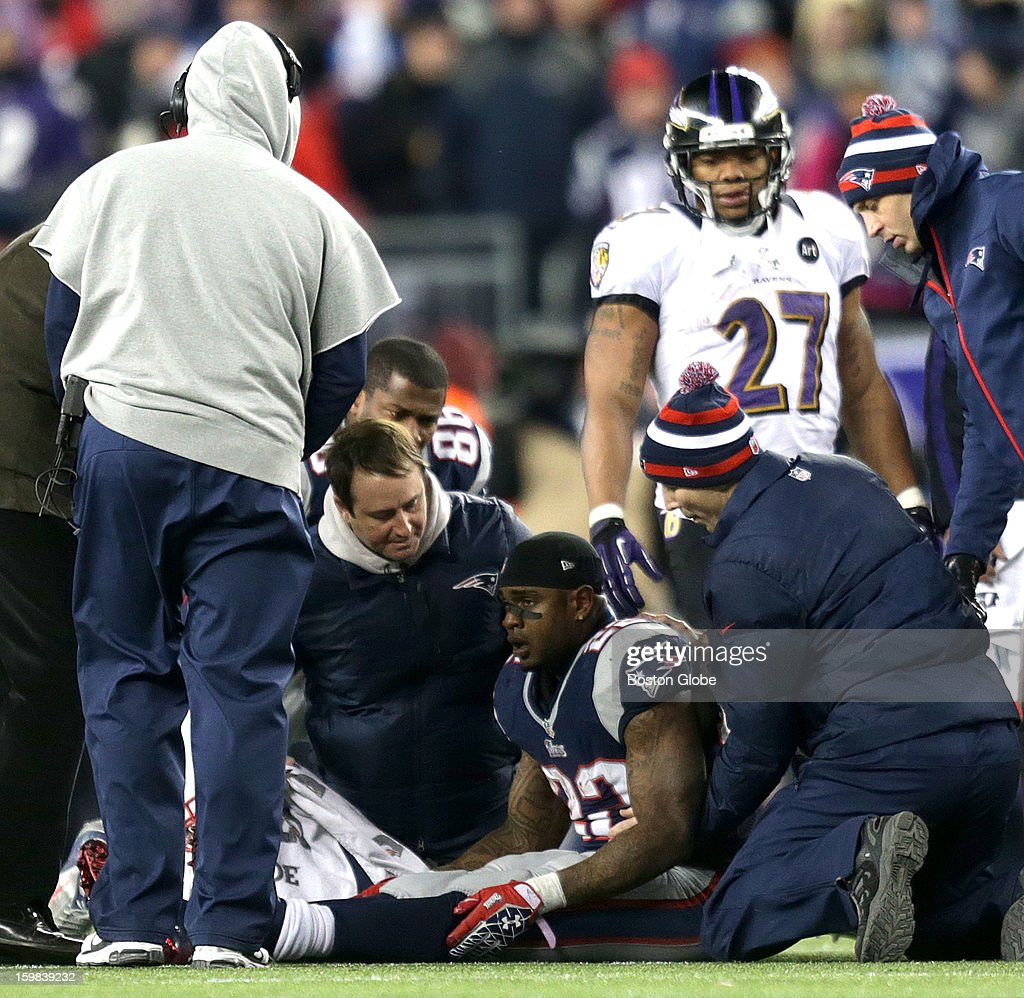 A dazed New England Patriots running back Stevan Ridley (#22) on the ground after losing consciousness after a hit and fumbling in the fourth quarter as the New England Patriots hosted the Baltimore Ravens in the AFC Championship Game at Gillette Stadium.