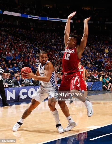 Dazon Ingram of the Alabama Crimson Tide defends Isaiah Briscoe of the Kentucky Wildcats in an SEC Tournament Semifinal game at Bridgestone Arena on...