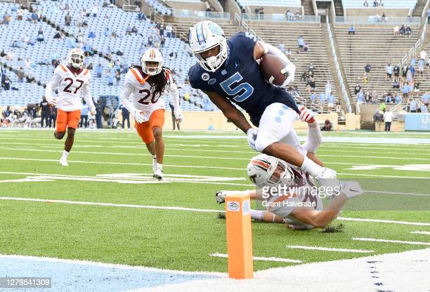 Dazz Newsome of the North Carolina Tar Heels beats Tyler Matheny of the Virginia Tech Hokies for a touchdown during their game at Kenan Stadium on...