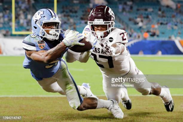 Dazz Newsome of the North Carolina Tar Heels catches a 28-yard touchdown pass from Sam Howell against the Texas A&M Aggies during the first half of...