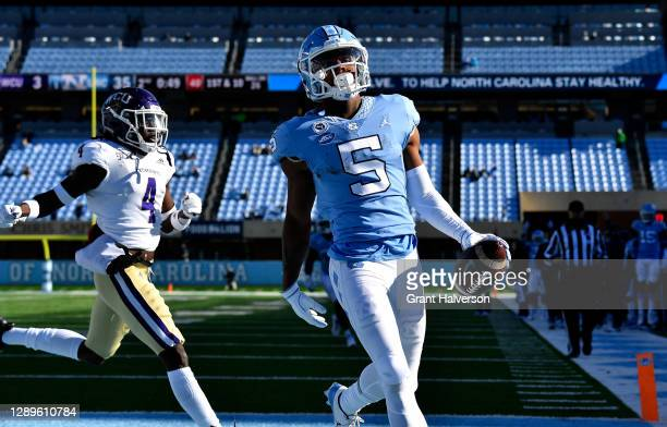 Dazz Newsome of the North Carolina Tar Heels scores a touchdown against A.J. Rogers of the Western Carolina Catamounts during their game at Kenan...