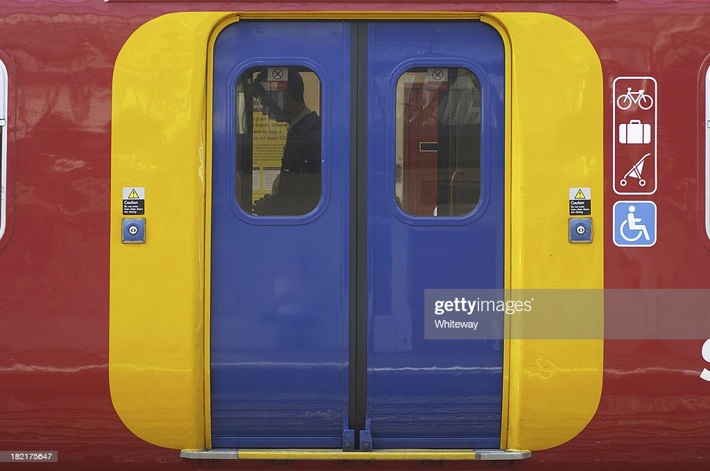 Access via brightly colored doors on an overground train : Stock Photo