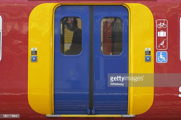 access via brightly colored doors on an overground train - vehicle door stock pictures, royalty-free photos & images