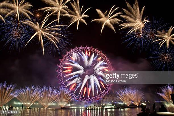 Dazzling fireworks display around the EDF Energy London Eye on the Southbank bought in the New Year. Up to 250,000 people packed in along the banks...