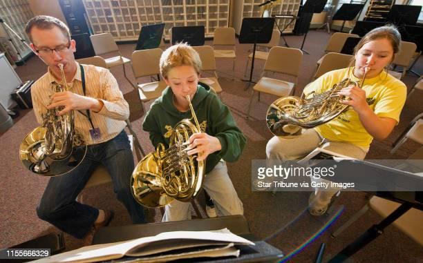 BREWSTER • dbrewster@startribunecom Thursday_10/30/08_Crystal FAIR School Band director Todd Boyd works with two students Sam Loben and Annika...