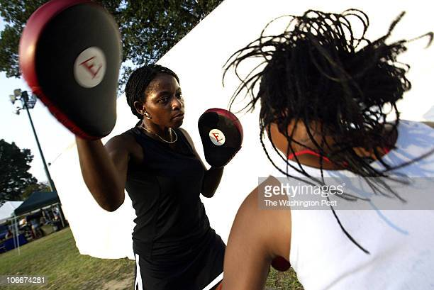 "Dc-cover10 Mark Gail_TWP Boxer Lisa ""Too Fierce"" Foster spars with her daughter Taylor before a demonstration at the National Night Out event at..."