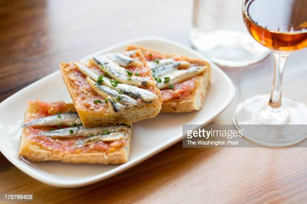 The toasted bread with white anchovies with a glass of sherry at Mockingbird Hill Washington DC