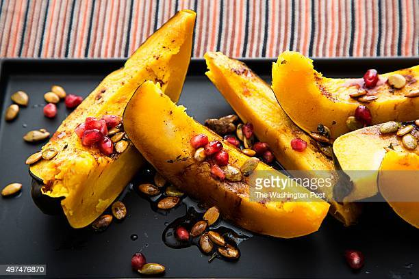 Roasted Acorn Squash with Pumpkin Seeds and Pomegranate