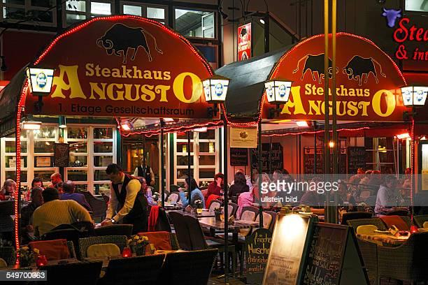 DCologne old city Martin quarter people sitting in a sidewalk restaurant night shot