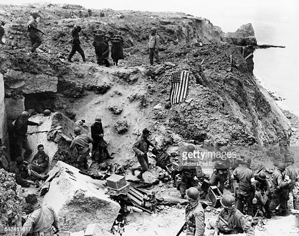 DDay Allied forces have taken a German coastal battery at Pointe de Hoc west of Omaha Beach and taken prisoners the starspangled banner on the rock...