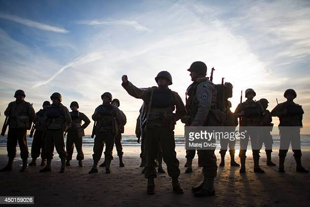Day reenactment enthusiasts dressed as World War II American soldiers are seen during a gathering on the Omaha Beach to commemorate the sacrifices of...