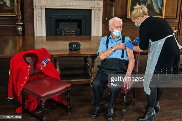Day veteran and Chelsea Pensioner Bob James Sullivan a resident at the Royal Hospital Chelsea, is injected with the Pfizer/BioNTech Covid-19 vaccine...