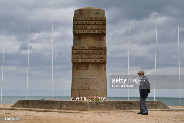 Day veteran Donald Hendrey looks at the monument on Juno beach at Courseulles-sur-Mer in Normandy, north-western France, on June 7, 2019 as...