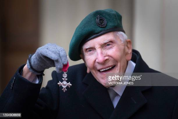 DDay veteran HarryBillinge poses with their medal after being appointed a Member of the Order of the British Empire for services to charitable...
