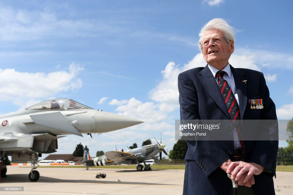 D-Day veteran Paddy Byrne poses alongside an RAF Eurofighter Typhoon and RAF Spitfire during the unveiling of the commemorative D-Day Eurofighter Typhoon jet at RAF Coningsby on May 21, 2014 in Coningsby, England. This year commemorates the 70th anniversary of the D-Day landings on the 6th June. The attack saw more than 156,000 Allied troops storm the beaches of France and eventually led to the Allied liberation of France in 1944.