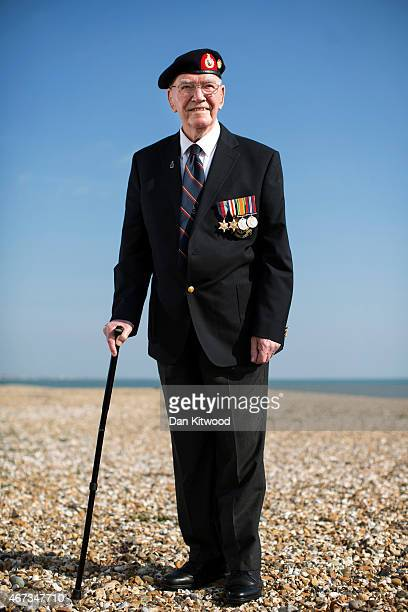 Day veteran Ted Turner poses before being awarded the 'Legion dHonneur' at a ceremony at the Royal Marines Museum in Southsea on March 23, 2015 in...