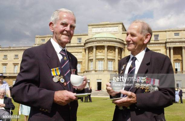 DDay veteran Walter Chamberlain of Oldham Greater Manchester enjoys a cup of tea with longlost friend Bert Darnell at a garden party for the Not...