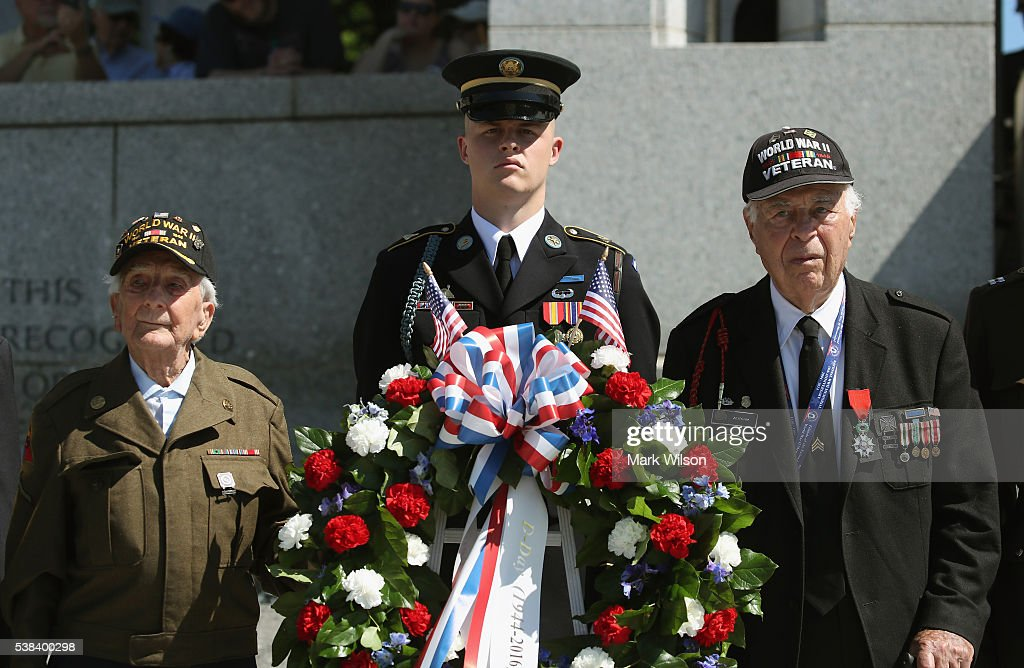 D-Day veterans, 96 year old George Krakosky (L), and 92 year old Herman Zeitchik (R), attend a D-Day anniversary wreath laying ceremony at the National World War II Memorial on June 6, 2016 in Washington, DC. It was 72 years ago today when Krakosky landed on Omaha Beach with the US Army 29th Infantry Division, and Zeithchik landed on Utah Beach with the US Army 4th Infantry Division