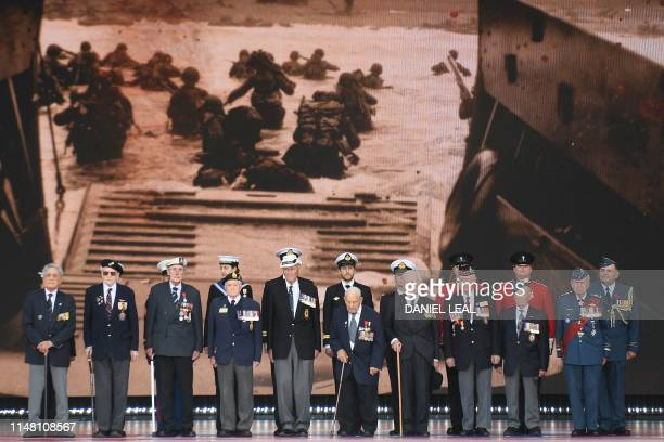 DDay veterans are presented on stage during an event to commemorate the 75th anniversary of the DDay landings in Portsmouth southern England on June...