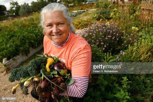 dDENVER CO SEPTEMBER 28 Donna Garnett shows off some of the abundant produce grown at the Urban Farm at the United Methodist ChurchMontbello on...