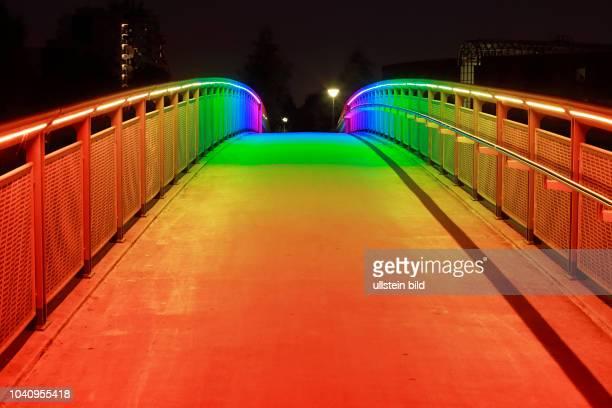 DDortmund Ruhr area Westphalia North RhineWestphalia NRW DDortmundDorstfeld Regenbogenbruecke rainbow bridge across the A40 footbridge night blue...