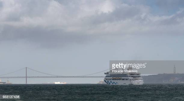 25 de Abril bridge and National Sanctuary of Christ the King are seen in the distance as Italy registered cruise ship AIDAvita owned by Costa...