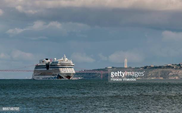 25 de Abril bridge and the National Sanctuary of Christ the King are seen in the distance as Italy registered cruise ship AIDAblu owned by Costa...