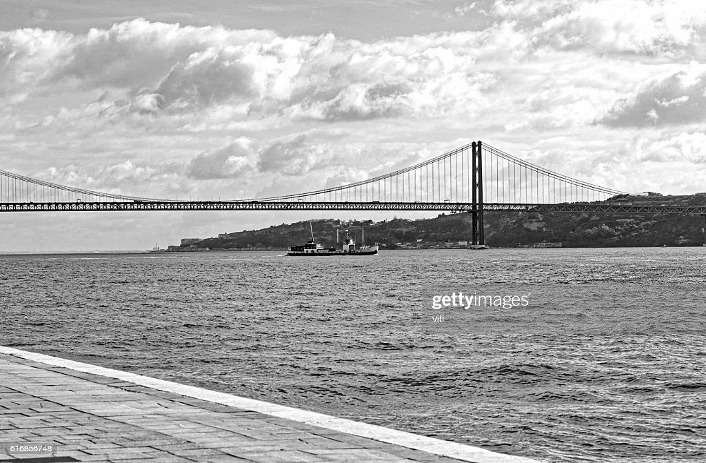 25 de Abril Bridge over the Tagus River : Stock Photo