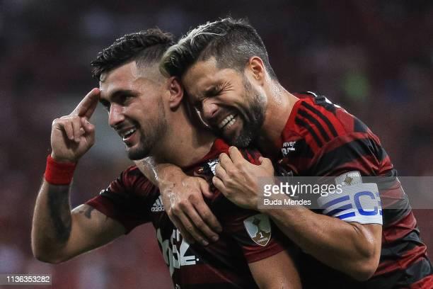 De Arrascaeta and Diego of Flamengo celebrate a scored goal during a match between Flamengo and San Jose BOL as part of Copa CONMEBOL Libertadores...