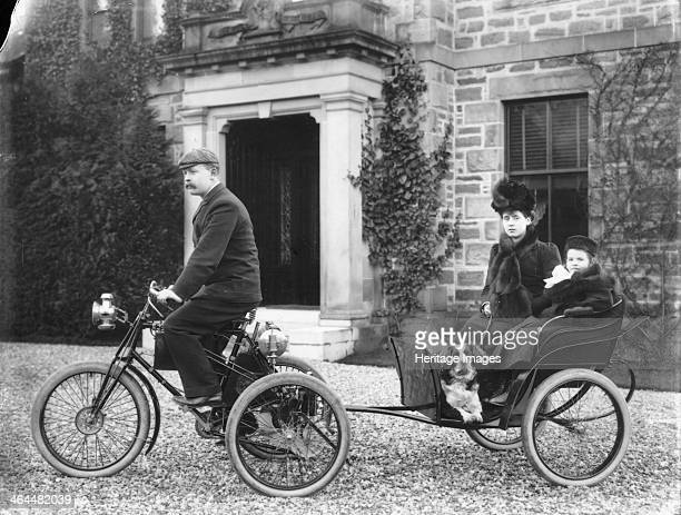 A De Dion tricycle A man riding the tricycle pulling his wife daughter and dog in a seat behind him The De Dion tricycle was the invention of Count...