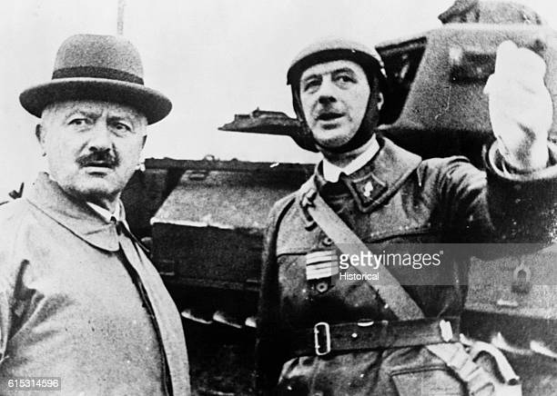 De Gaulle stands in the uniform of a tank commander with President Lebrun