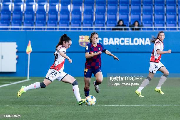 L de Guerenu of Rayo Vallecano competes with Aitana Bonmati of Fc Barcelonaduring the Spanish League Primera Iberdrola women football match played...