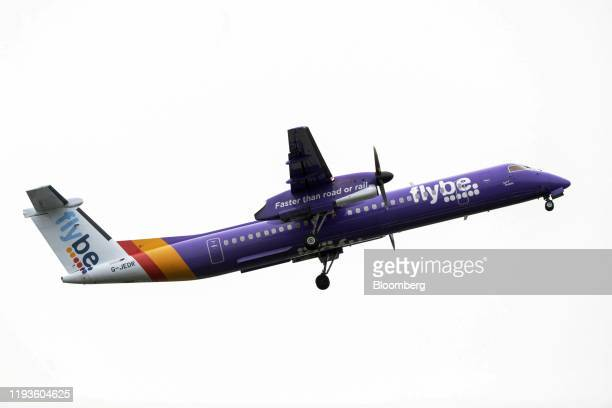 A De Havilland Canada Dash 8400 passenger aircraft operated by Flybe Group Plc takes off from London City Airport in London UK on Tuesday Jan 14 2020...