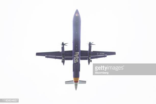 A De Havilland Canada Dash 8400 passenger aircraft operated by Flybe Group Plc prepares to land at London City Airport in London UK on Tuesday Jan 14...