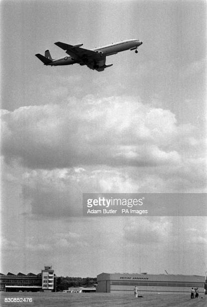 A De Havilland DH 106 Comet the world's first commercial jet airliner flies over the British Aerospace Commercial Aircraft headquarters at Hatfield...