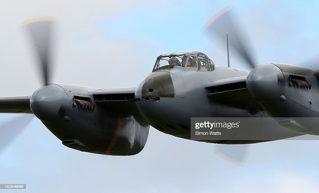 de Havilland Mosquito KA 114 performs a low pass during an airshow commemorating the completion of its rebuild on September 29, 2012 in Ardmore, New Zealand. The plane was restored by Warbird Restorations at Ardmore Aerodrome and is the only flying Mosquito in the world.