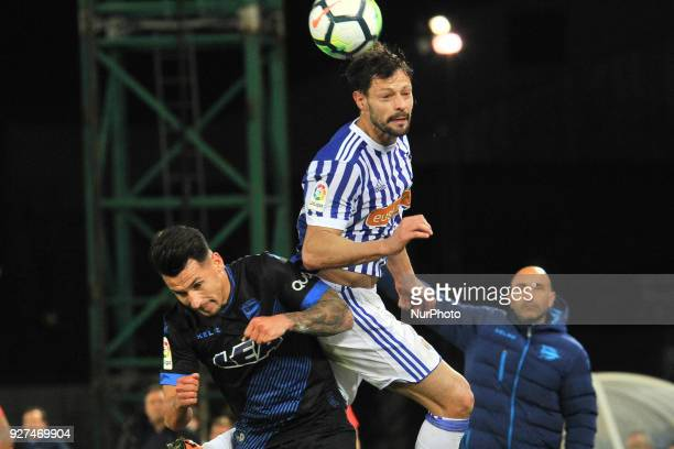 De la Bella of Real Sociedad duels for the ball with Hernan Perez of Alaves during the Spanish league football match between Real Sociedad and Alaves...