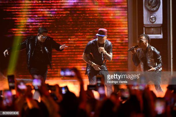De La Ghetto Wisin and Ozuna perform on stage during Univision's 'Premios Juventud' 2017 Celebrates The Hottest Musical Artists And Young Latinos...