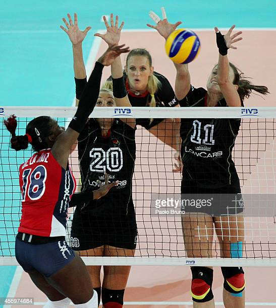 De La Pena De La Cruz of Dominican Republic spikes the ball as Mareen Apitz and Christiane Furst of Germany blocks during the FIVB Women's World...