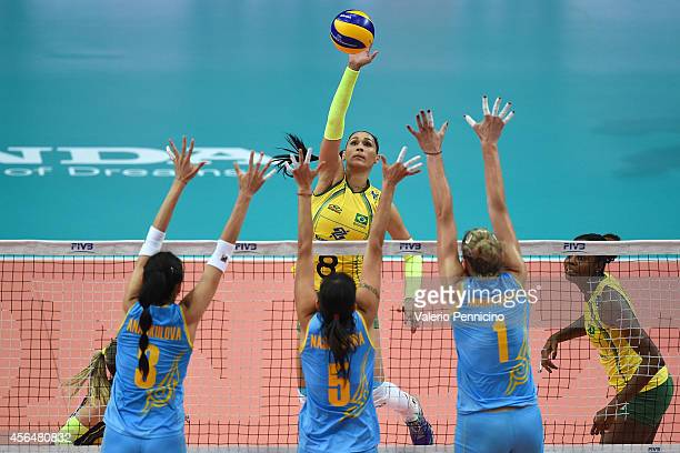 De Paula Castro of Brazil spikes against Kazakhstan block during the FIVB Women's World Championship pool F match between Brazil and Kazakhstan on...