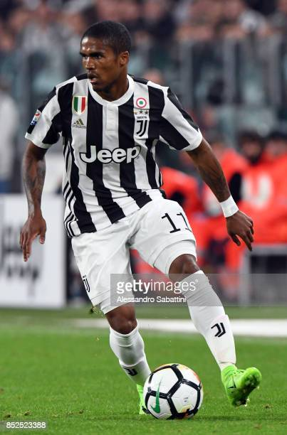 De Suoza Douglas Costa of Juventus in action during the Serie A match between Juventus and Torino FC on September 23 2017 in Turin Italy