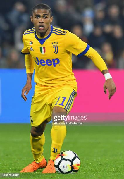 De Suoza Douglas Costa of Juventus in action during the serie A match between Spal and Juventus at Stadio Paolo Mazza on March 17 2018 in Ferrara...