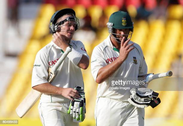 AB de Villiers and Jacques Kallis of South Africa leave the field with an unbroken partnership of a 100 runs during day one of the second test match...