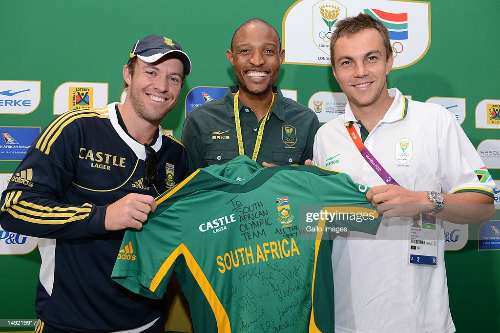 AB de Villiers, Khotso Mokoena and LJ van Zyl pose during the South African Olympic Team Press Conference from Copthorne Tara Hotel, Kensington on July 25, 2012 in London, England.