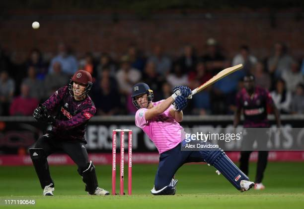 De Villiers of Middlesex hits out as Tom Banton of Somerset looks on during the Vitality Blast match between Somerset and Middlesex at The Cooper...
