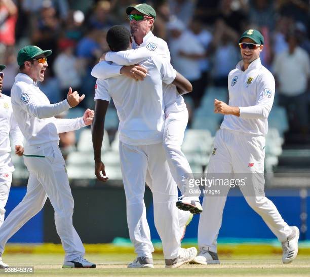 AB de Villiers of South Africa celebrate with Kagiso Rabada of South Africa during day 2 of the 3rd Sunfoil Test match between South Africa and...